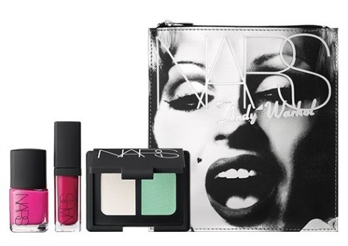 Beautiful Darling set contains Candy Darling Nail Polish, Femme Fatale Duo Eyeshadow and Woman in Revolt Larger Than Life Lip Gloss in a makeup bag with an image of Darling, one of Warhol's muses, shot by Nat Finkelstein.