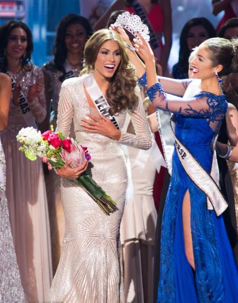 Gabriela Isler, Miss Venezuela 2013, is crowned the winner by Olivia Culpo, Miss Universe 2012, onstage during MISS UNIVERSE® 2013 from Crocus City Hall in Moscow, Russia on November 9, 2013